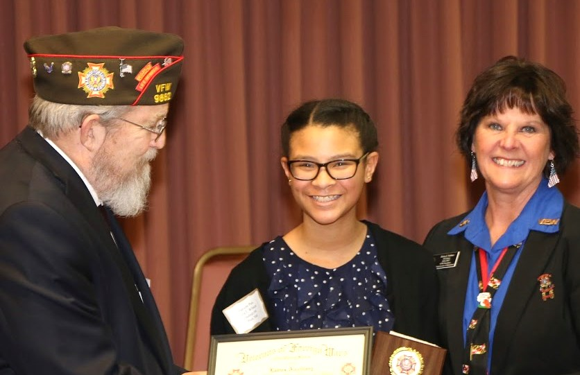 State Commander and President awarding citation and monetary award to a young lady for placing in the Patriot's Pen Contest.