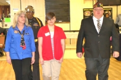 District Commander and President escorting their contestant to the podium.
