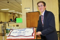 This year's Voice of Democracy Contest with a cake celebrating his win.