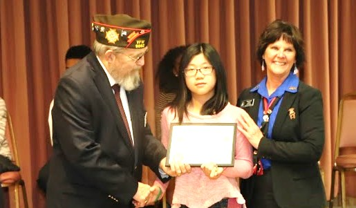 State Commander and President awarding citation to young lady for her efforts.