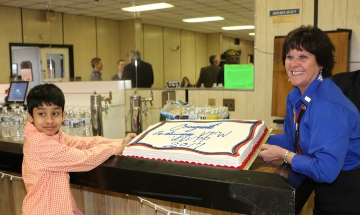 Patriot's Pen winner and Auxiliary President showing off cake in his honor.